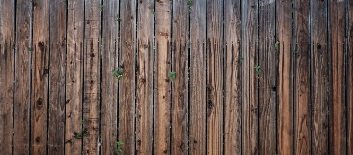Wood is less expensive to install but harder to maintain